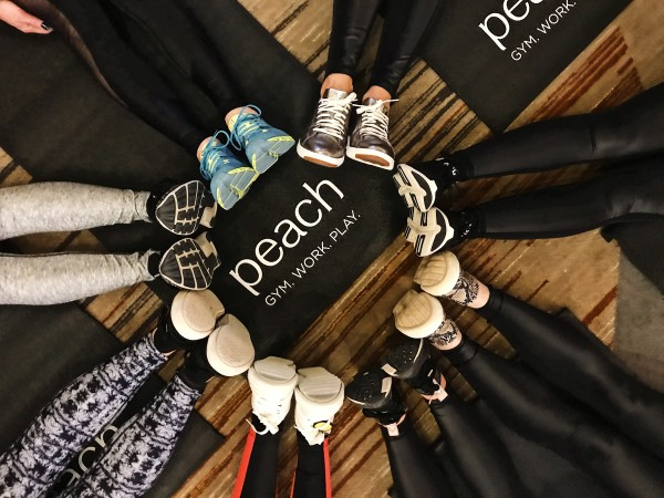 Peach Stylists getting ready for a group yoga class during SuccessFest, our annual Stylist conference.