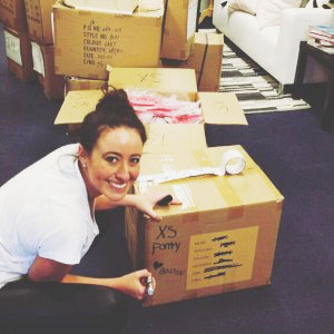 Francesca D., of our Field Development & Training team, readies boxes for UPS.